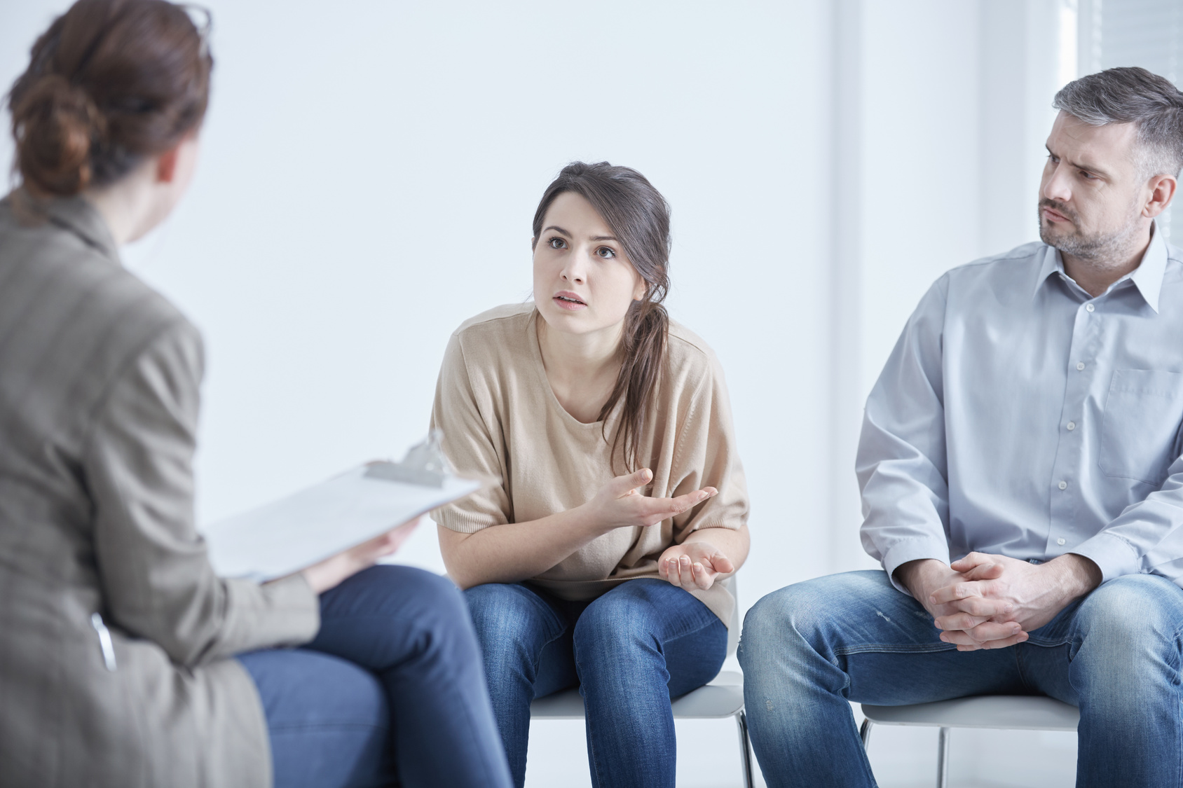 Worried troubled couple on marriage therapy with psychologist